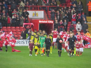 The teams come on to the pitch