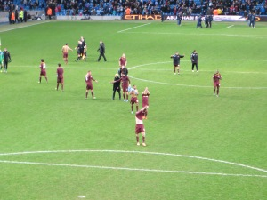 Applauding the travelling fans