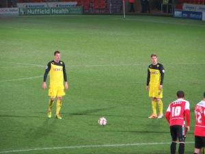 Tozser and Merkel line up a free kick