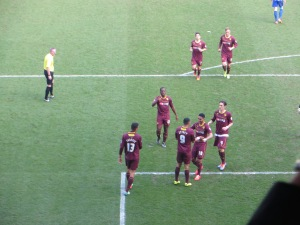 Deeney receives congratulations from the scorers of the first two goals