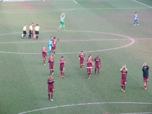 The players thanking the travelling faithful