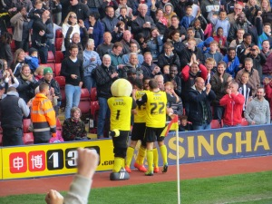 McGugan congratulated by his team mates