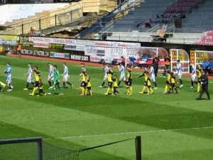 The teams coming on to the pitch