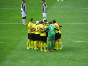 First pre-match huddle of the season at Vicarage Road