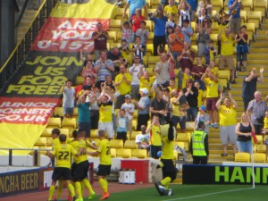 Deeney receives his team mates' congratulations