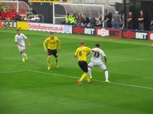 Wilson shielding the ball from Ekstrand
