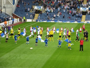 The teams take to the pitch at Ewood Park