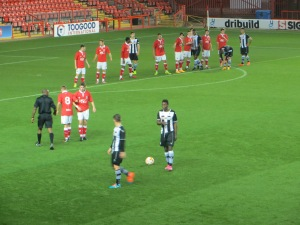 Mensah and Murray prepare for a free-kick