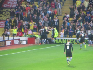 Harry joins in the celebrations for the third goal