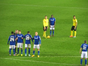 Tozser readies himself for a disappointing free-kick