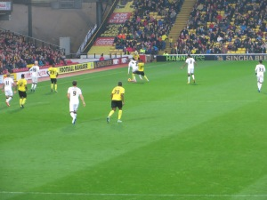 Keogh holds off Ighalo as Harry Hornet looks on