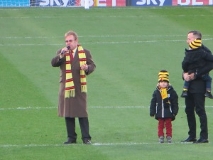 Elton, David, Zachary and Elijah on the pitch as the SEJ stand is opened