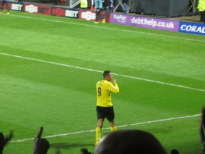 Deeney celebrates his second goal with the Rookery