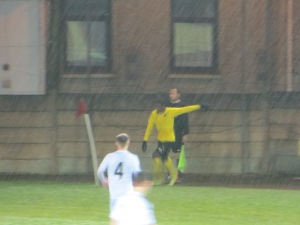 Folivi takes a corner in the driving rain