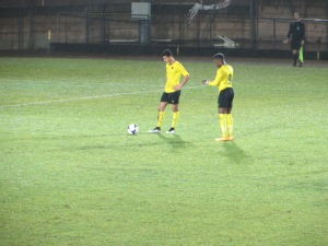 Kyprianou and Obi line up to take a free kick