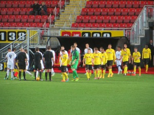 The teams take the field