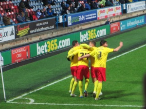 Celebrating Ighalo's goal