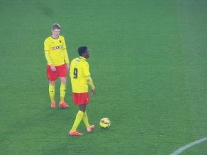 Byers and Mensah line up a free kick