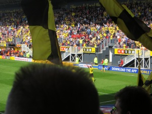 Ighalo's goal celebration obscured by that in the stands