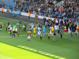 The teams take to the pitch