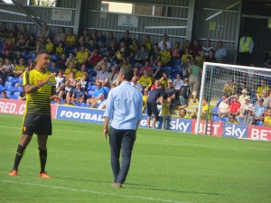 Deeney in discussion with Flores