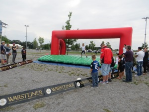 Bouncy castle with footballs being fired at the 'goalie'