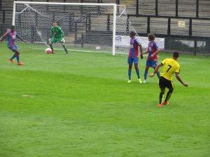 Lewis takes a free kick