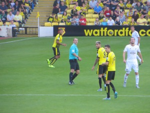Deeney, Behrami and Cathcart awaiting a free kick