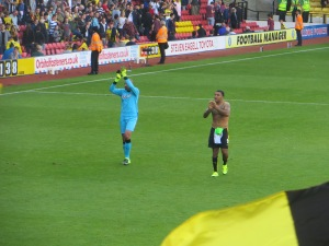 Gomes and Deeney applaud the crowd