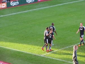 Deeney congratulating Abdi after he scored the second