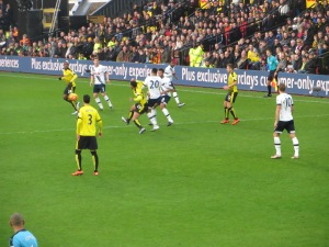 Capoue passes under a challenge from Alli
