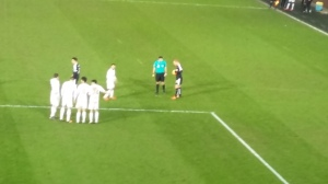 Watson preparing for a free kick