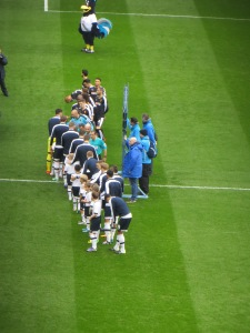 The teams line up for the handshake