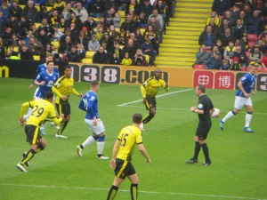 Ighalo, Deeney and Capoue challenge in the box