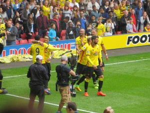 Pereyra congratulates Deeney on his penalty