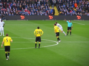 The opening scorer lines up for the restart