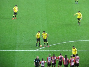 Deeney and Holebas discuss a free kick