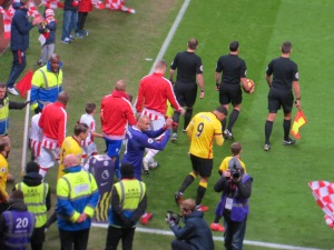 The teams emerge from the tunnel in Stoke