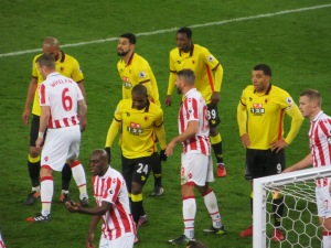 Folivi joins his team mates waiting for a corner