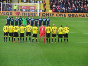 The players lined up for the minute's applause