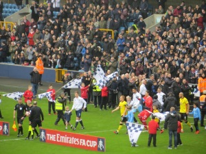 Ben Watson leading the team out at the Den