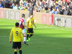 Zarate and Deeney wait for a throw-in