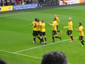 Deeney and Niang celebrate the first goal