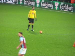 Britos lines up a free kick